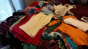 pile of clothes on a bed